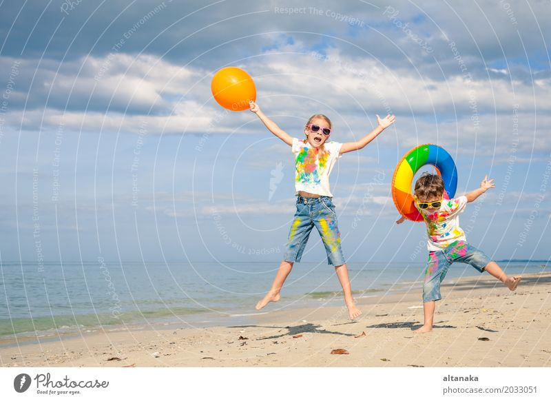 Happy children playing on the beach Lifestyle Joy Beautiful Relaxation Leisure and hobbies Playing Vacation & Travel Adventure Freedom Summer Sun Beach Ocean