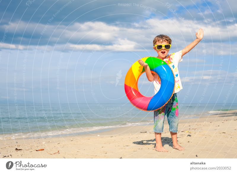 Little boy with rubber ring Human being Child Nature Vacation & Travel Man Summer Sun Hand Ocean Relaxation Joy Beach Adults Lifestyle Emotions Boy (child)