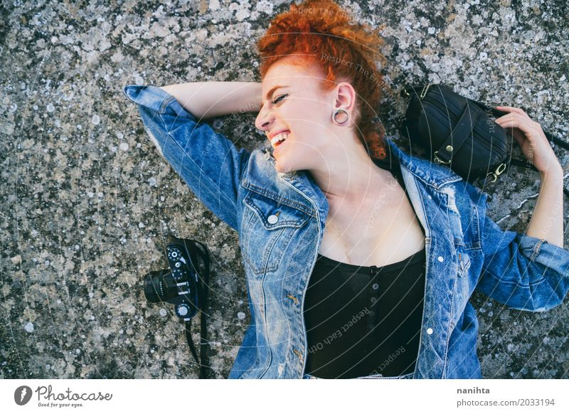 Young redhead woman lying on floor with her bag and her camera Human being Vacation & Travel Youth (Young adults) Young woman Beautiful 18 - 30 years Adults