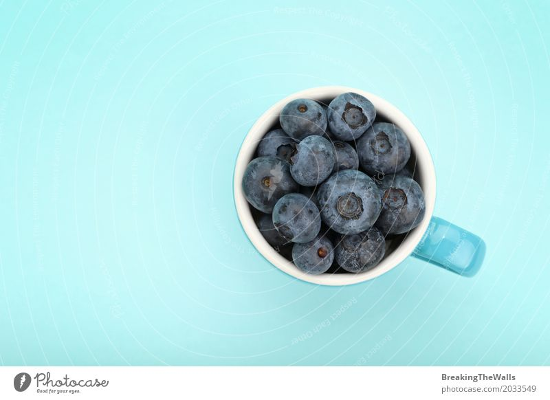Blueberries in a blue cup, top view Food Fruit Diet Mug Healthy Eating Blueberry Blue background Bird's-eye view Fresh Berries Nutrition Portion Vitamin