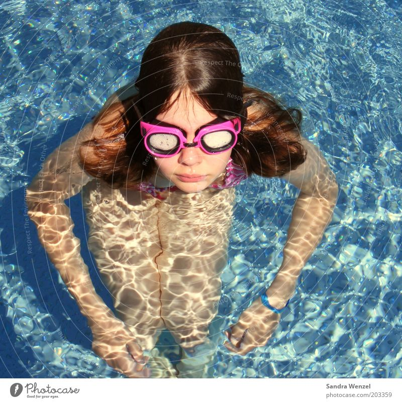 Human being Child Youth (Young adults) Girl Summer Warmth Waves Infancy Swimming & Bathing Leisure and hobbies Eyeglasses Swimming pool Observe Brunette