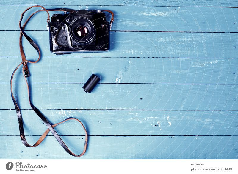 Vintage camera in a leather case on a blue wooden surface Camera Wood Old Retro Blue Brown Photography cover blank space device Top Shabby vintage board Lens
