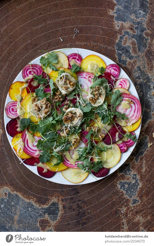 Beetroot with baked goat cheese and roasted walnuts Food Vegetable Lettuce Salad Red beet Goat`s cheese Walnut Nutrition Lunch Dinner Buffet Brunch
