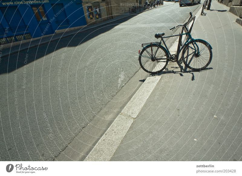 Blue Street Line Bicycle Asphalt Store premises Sidewalk Parking Curbside Traffic lane Lanes & trails Parking area