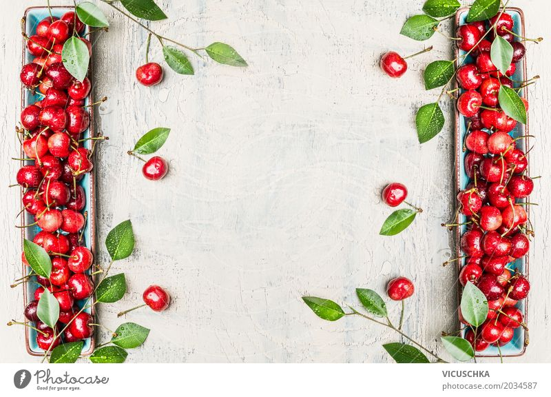 Background with red cherries and green leaves Food Fruit Nutrition Organic produce Vegetarian diet Diet Style Design Healthy Healthy Eating Life Summer Garden