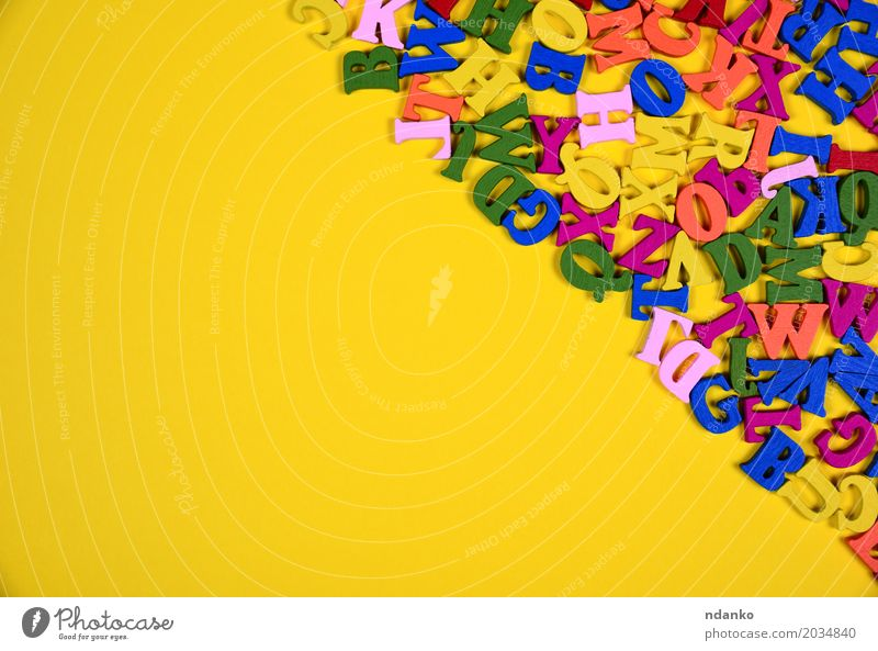 Multicolored wooden letters of the English alphabet Colour Joy Yellow Wood Above Decoration Symbols and metaphors Card Word Know Text Conceptual design Half