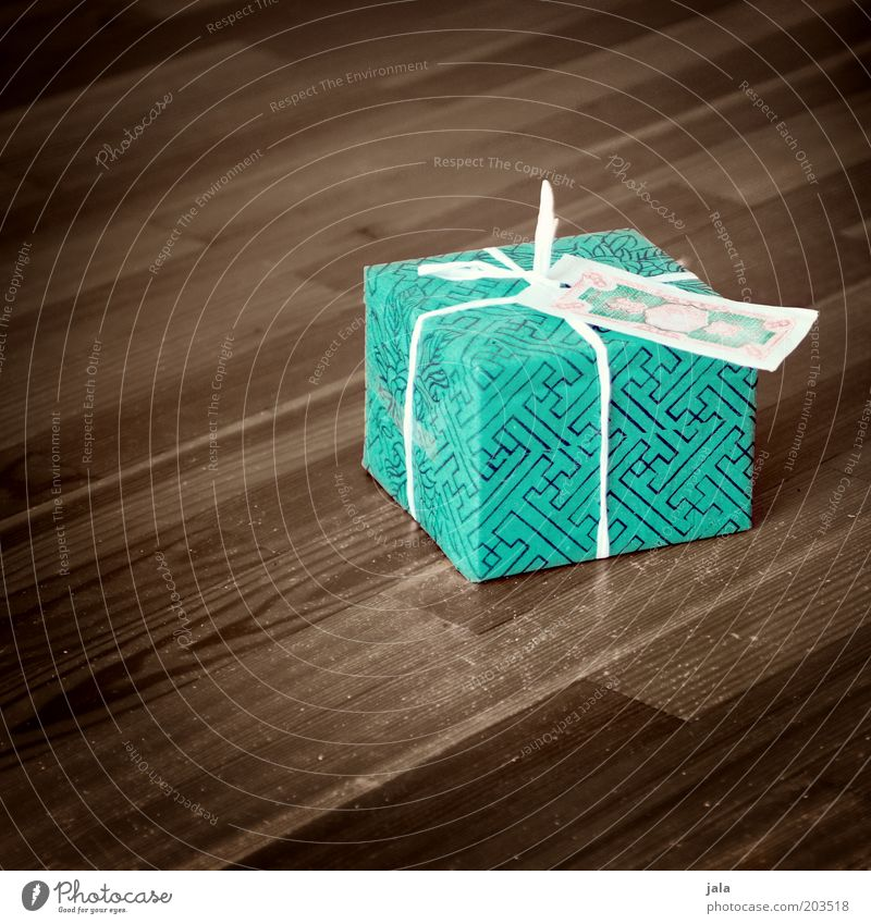 happy birthday, speedy Birthday Gift wrapping Parquet floor Beautiful Brown Green Joy Surprise Anticipation Packaged Colour photo Interior shot Deserted