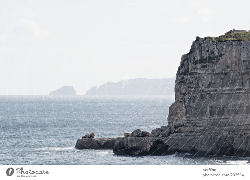 Cape of high expectations Cloudless sky Summer Beautiful weather Rock Coast Bay Ocean Mediterranean sea Majorca Steep Cliff Colour photo Subdued colour
