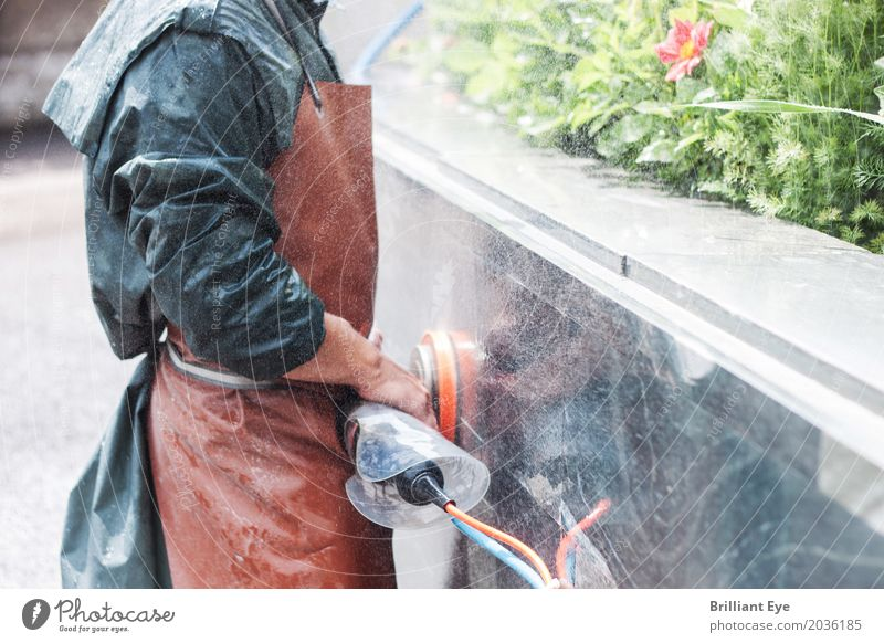 handyman working with grinding machine on a garden outside wall surface wet manual stone natural grinder tool sander occupation people skill worker technology