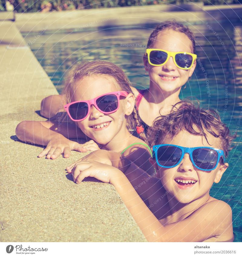 Three happy children playing on the swimming pool Child Vacation & Travel Summer Water Sun Relaxation Joy Face Lifestyle Funny Sports Boy (child) Laughter