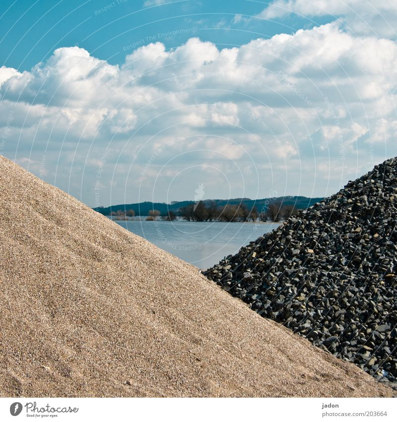 triangular history Construction site Water Sky Clouds River bank Build Heap Triangle Flood Safety Deserted Raw materials and fuels Day Lake Stone Pile of stones