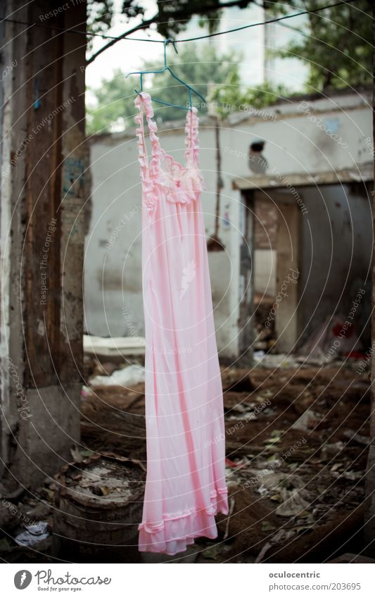dryer broken Exhibition China Xian Asia Wall (barrier) Wall (building) Facade Dress Night dress Bizarre Whimsical Ruin Destruction Derelict Pink Gray Trash