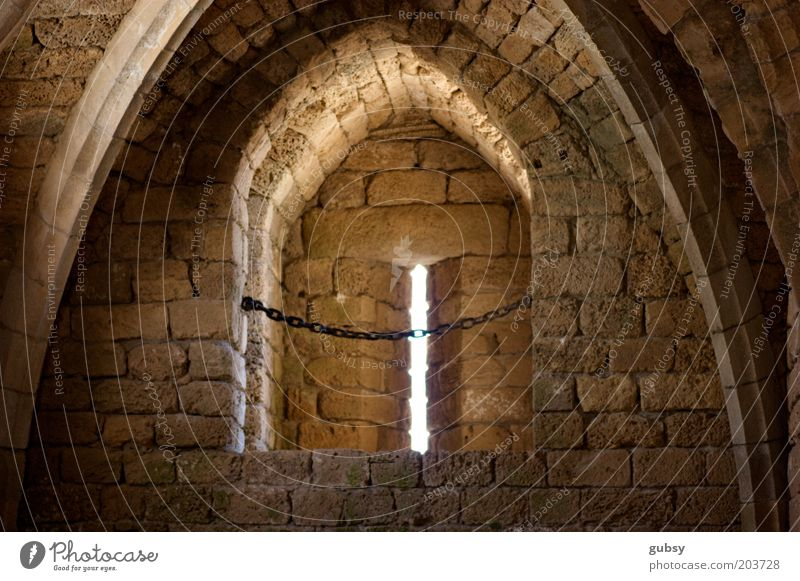 ceasarea Israel Near and Middle East Ruin Window Chain Brick Arch Roman era Penitentiary Remote Subdued colour Interior shot Deserted Day Sunlight