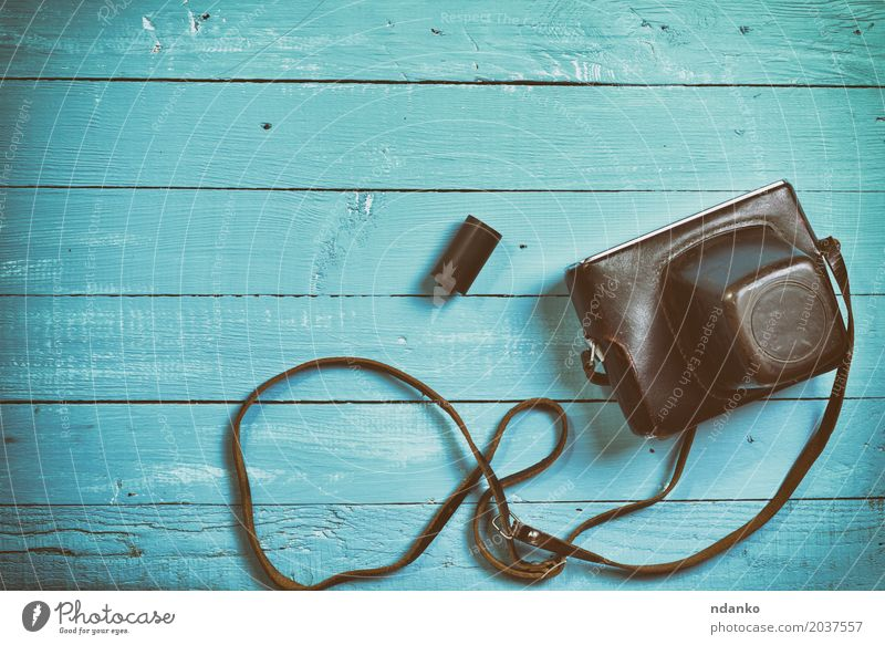Vintage film camera in a leather case Camera Wood Old Above Retro Blue Brown Photography cover blank space device Top Shabby vintage board Lens empty space