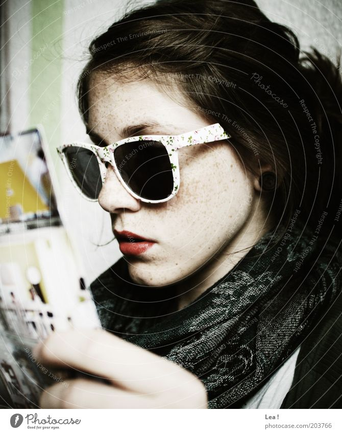 poker face Human being Feminine Youth (Young adults) Head 1 Accessory Sunglasses Reading Modern Colour photo Interior shot Day Central perspective Rag Magazine