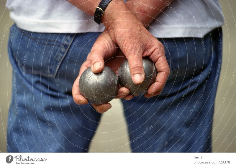 balls Boules Hand Jeans Detail Section of image Rear view Men`s hand Man Sphere boules ball boule balls To hold on