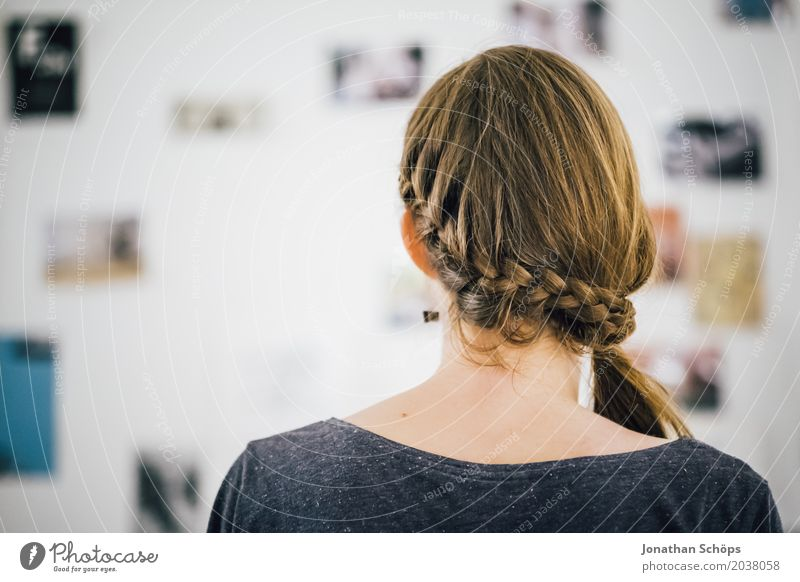 Back of a woman's head with braid In front of the picture wall with photos Hair and hairstyles Living room Human being Feminine girl Young woman