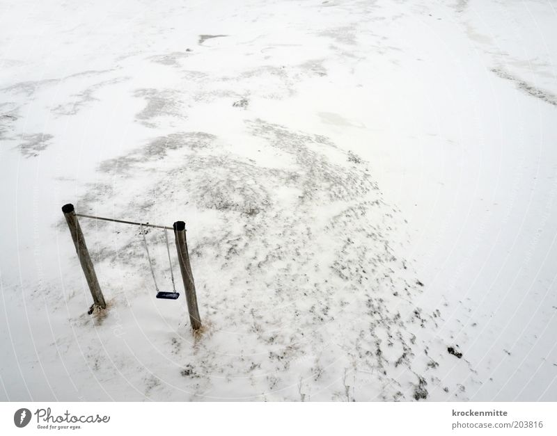 icy childhood Landscape Winter Bad weather Snow To swing Loneliness Swing Ice Wooden stake Cold Infancy Playground Bird's-eye view White Colour photo