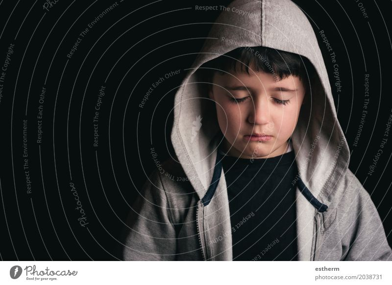 Sad boy on black background Child Head 1 Human being 3 - 8 years Infancy Sweater Black-haired Sadness Concern Grief Pain Loneliness Guilty Remorse Fear