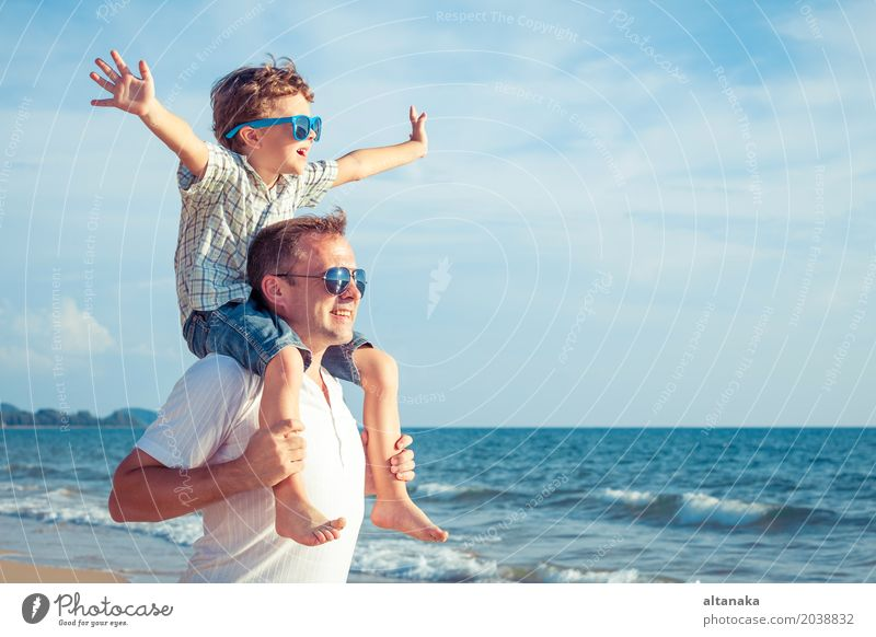 Father and son playing on the beach at the day time. Child Nature Vacation & Travel Man Summer Sun Hand Ocean Relaxation Joy Beach Adults Life Lifestyle Love