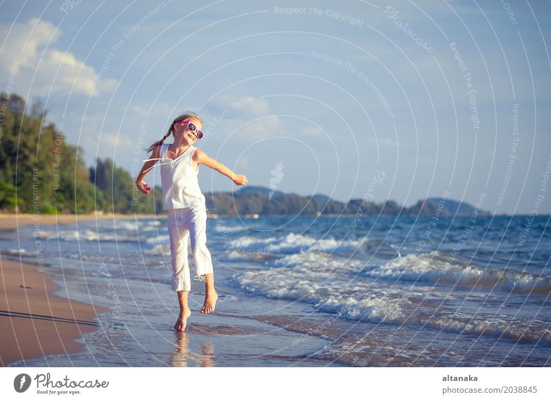 Little girl dancing on the beach at the day time Human being Child Woman Nature Vacation & Travel Summer Beautiful Sun Ocean Relaxation Joy Beach Adults