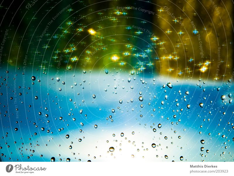 rain Window Window pane Glittering Drops of water Blue Blue sky Gold Colour photo Interior shot Copy Space bottom Copy Space middle Day Light Shadow Contrast