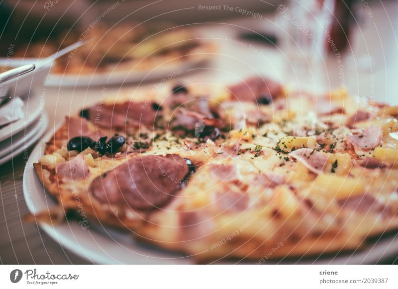 American Pizza on plate in Restaurant Food Meat Sausage Cheese Dough Baked goods Eating Lunch Dinner Fast food Italian Food Plate To enjoy Fat junk food indoor