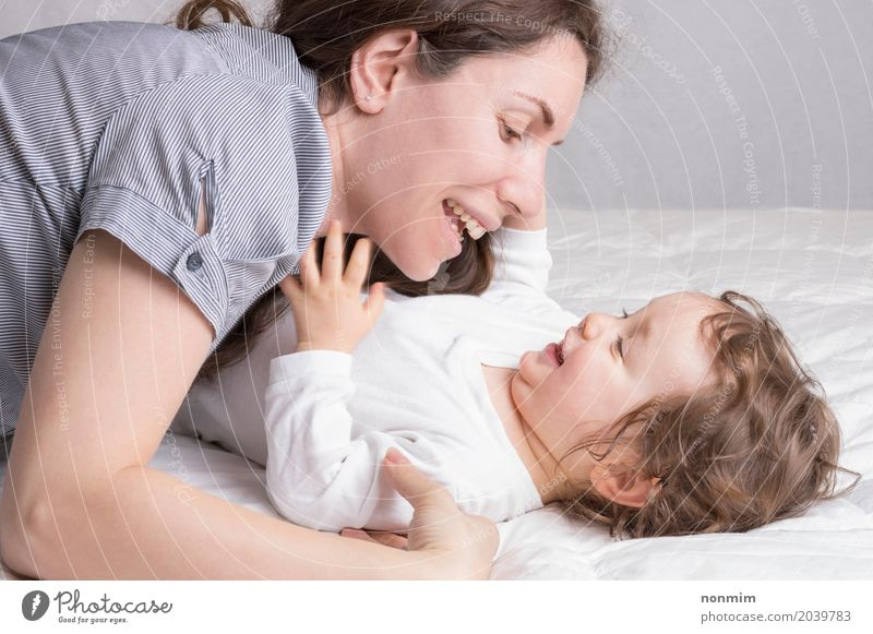 Baby girl playing with mother and have fun Joy Beautiful Playing Child Toddler Woman Adults Parents Mother Family & Relations Infancy Smiling Love Embrace
