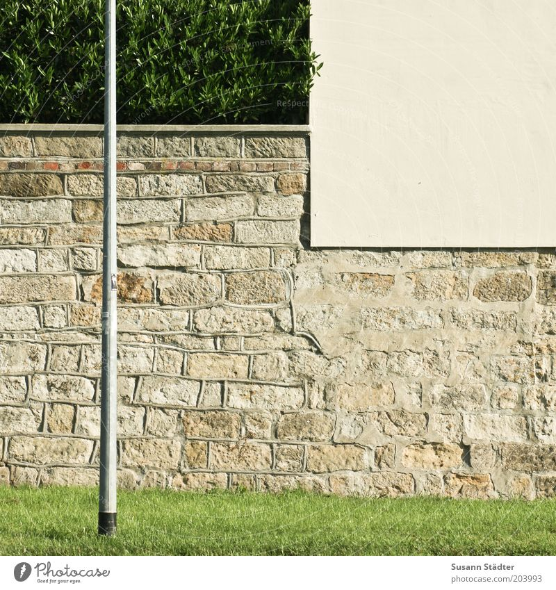 Wall (building) Grass Wall (barrier) Facade Bushes Lantern Barrier Hedge Sharp-edged Lamp post Boundary Sandstone Building stone Plastered Stone wall Natural stone