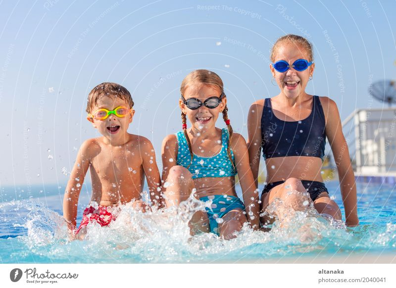 happy children playing near the swimming pool Lifestyle Joy Happy Face Relaxation Swimming pool Leisure and hobbies Playing Vacation & Travel Summer Sun Sports