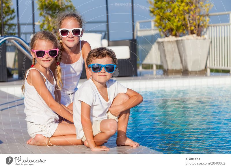 happy children playing near the swimming pool Child Vacation & Travel Summer Water Sun Relaxation Joy Face Lifestyle Funny Sports Boy (child) Laughter