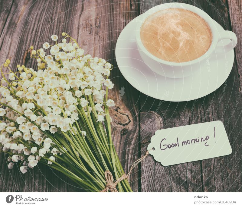 cup of hot black coffee and a bouquet Breakfast Hot drink Coffee Espresso Mug Table Restaurant Flower Bouquet Wood Blossoming Fresh Good Above Retro Brown Black