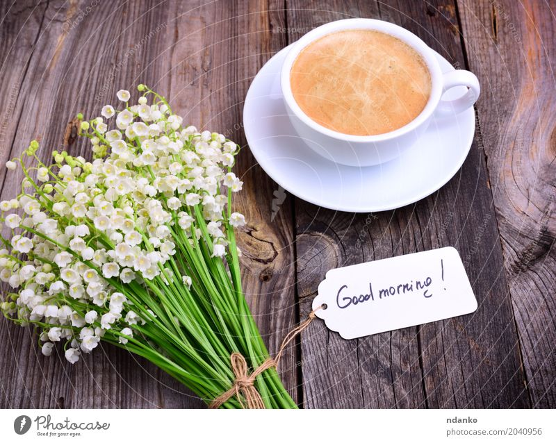 cup of hot black coffee and a bouquet Breakfast To have a coffee Hot drink Coffee Espresso Mug Table Restaurant Flower Bouquet Wood Eating Fresh Good Above