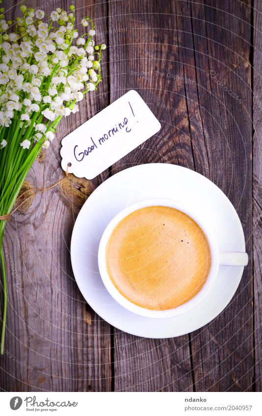 Cup of black coffee in a white cup Breakfast To have a coffee Hot drink Coffee Mug Flower Bouquet Wood Good Above Retro Gray White Joy Energy Lily of the valley