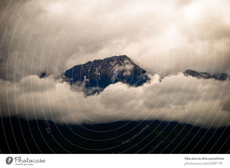 majestic. Far-off places Mountain Clouds Bad weather Fog Rain Rock Alps Peak Fog bank High fog Band of cloud Majestic Copy Space left Copy Space top
