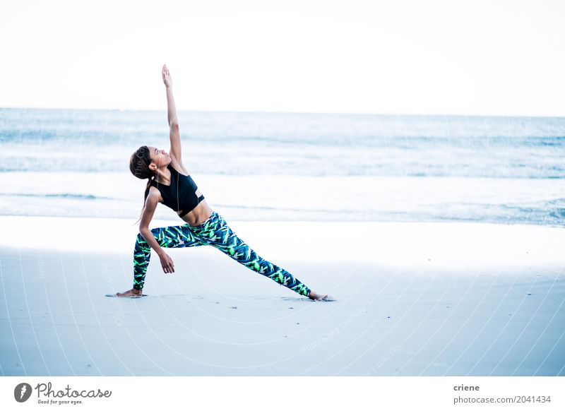 African American woman doing yoga exercise on beach Human being Woman Youth (Young adults) Young woman Ocean Beach 18 - 30 years Adults Life Lifestyle Sports