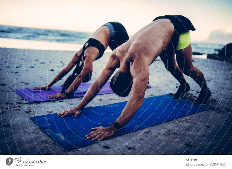 Fit young adult couple doing yoga on beach Lifestyle Personal hygiene Health care Athletic Fitness Leisure and hobbies Beach Ocean Waves Sports Yoga Woman