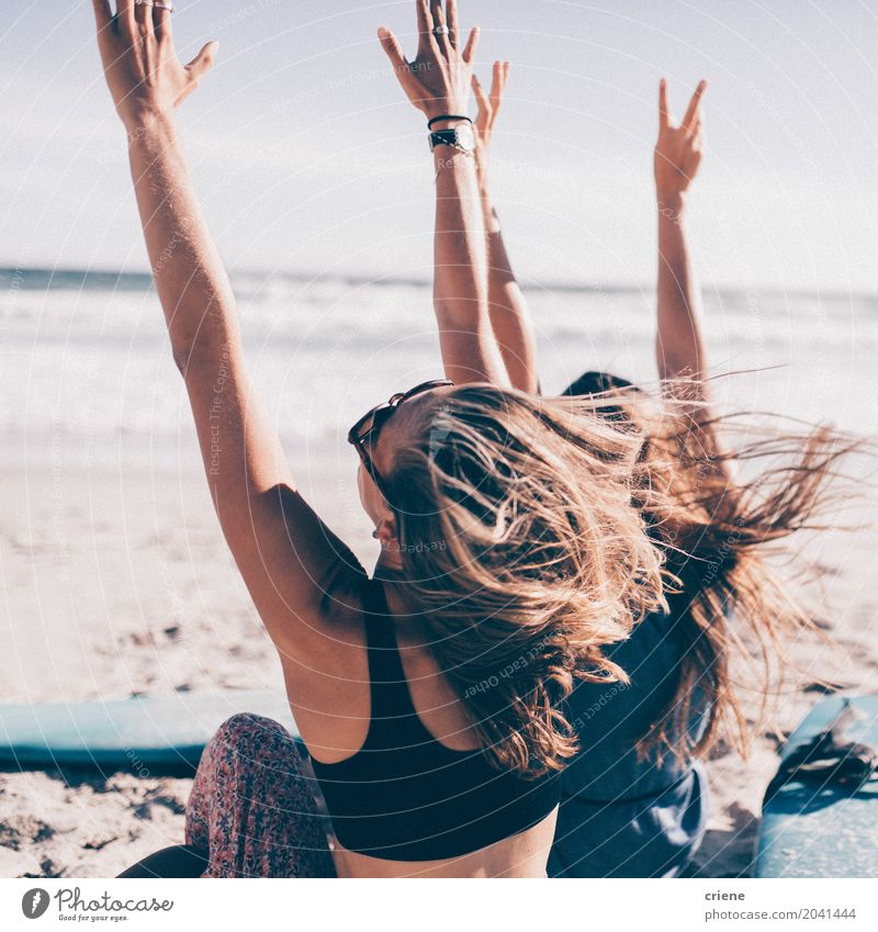Two young woman cheering with hands up at the beach Human being Woman Vacation & Travel Youth (Young adults) Young woman Summer Sun Ocean Joy Beach