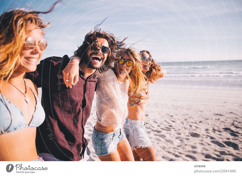 Group of young adult friends walking on the beach together Lifestyle Joy Vacation & Travel Summer Ocean Young woman Youth (Young adults) Young man Friendship