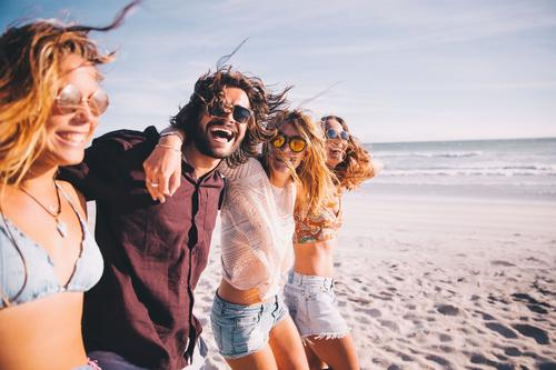 Group of young adult friends walking on the beach together Human being Vacation & Travel Youth (Young adults) Young woman Summer Young man Ocean Joy