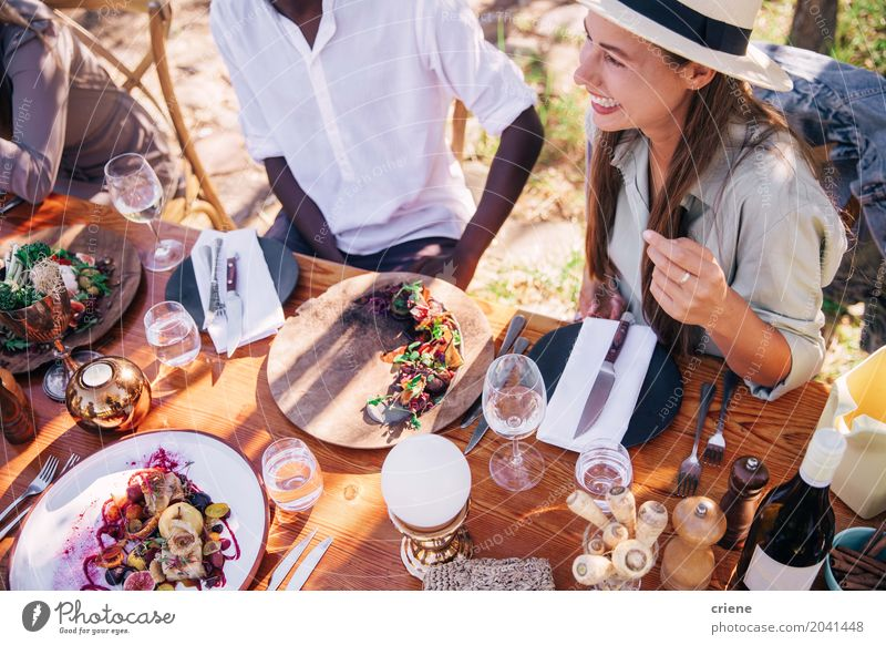 Group of young adult friends enjoying lunch together Eating Lunch Drinking Alcoholic drinks Plate Fork Lifestyle Summer Table Party Feminine Young woman