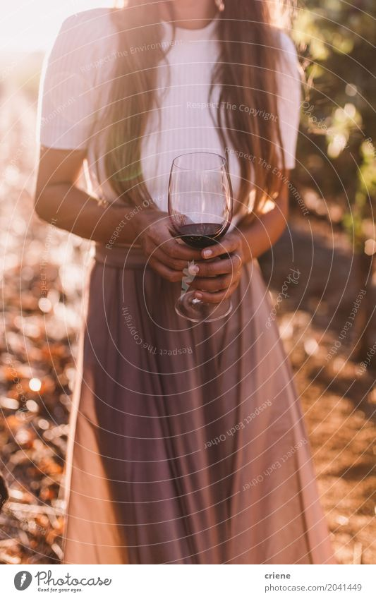 Close-up of woman holding wine glass on summer evening Human being Woman Youth (Young adults) Young woman Summer 18 - 30 years Adults Warmth Lifestyle Feminine