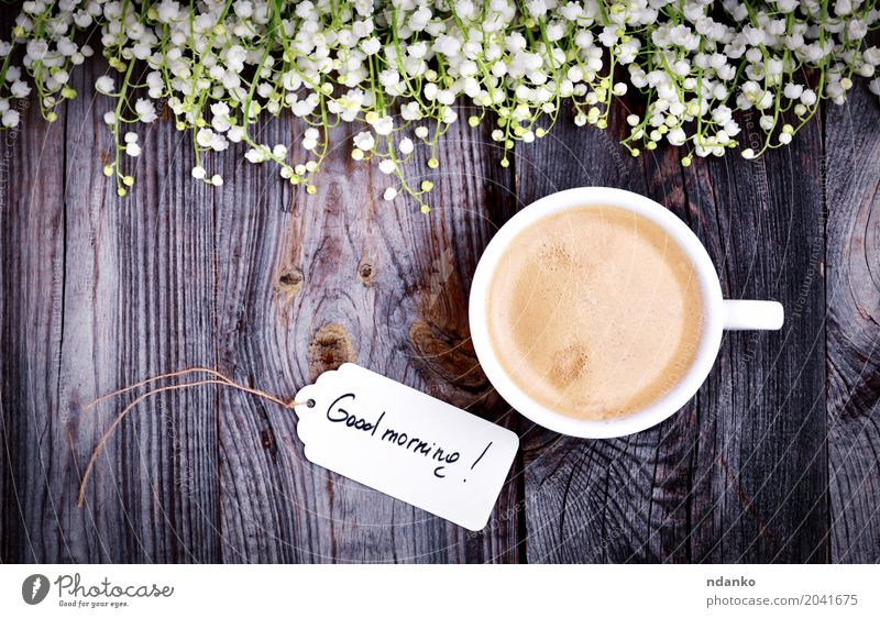 White cup with coffee on a gray wooden surface Breakfast Coffee Espresso Table Restaurant Flower Bouquet Wood Fresh Good Hot Above Retro Brown Café tag drink