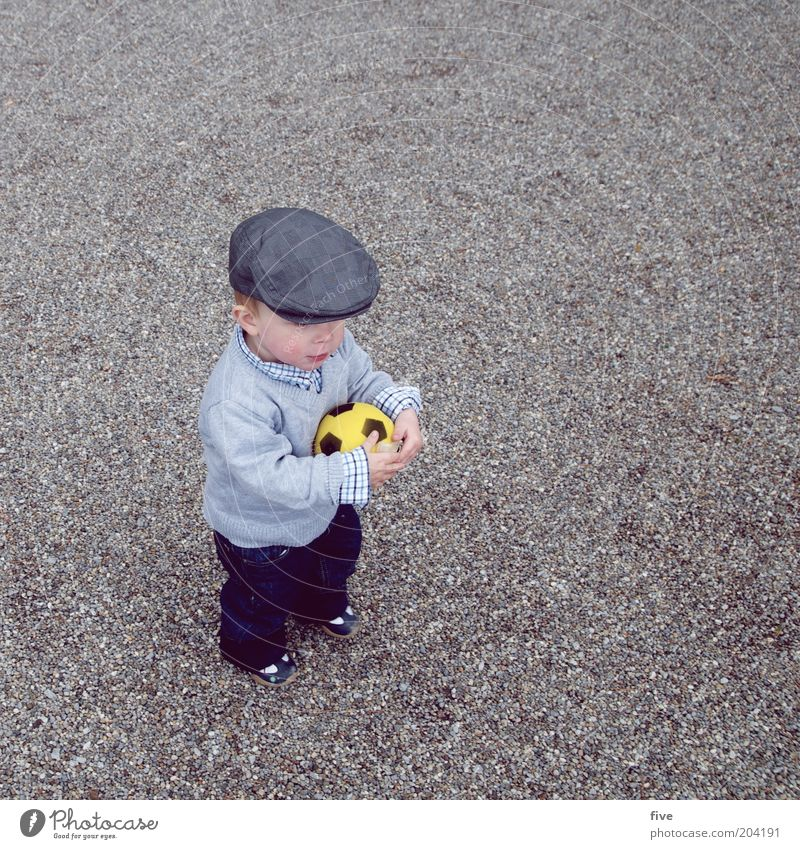 Human being Child Joy Sports Playing Boy (child) Happy Funny Contentment Infancy Leisure and hobbies Masculine Foot ball Toddler Cap Fan