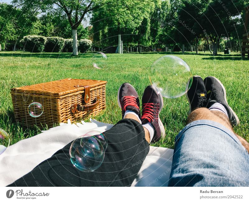 Romantic Couple Relaxing On Picnic Day In Spring Human being Woman Nature Vacation & Travel Youth (Young adults) Man Plant Blue Young woman Summer Colour Green Young man Relaxation Leaf Joy