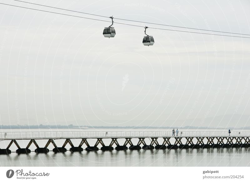 hover Vacation & Travel Sightseeing World exposition Air Water Lisbon Outskirts Bridge Cable car Suspension railway River River bank Tourist Attraction Gray
