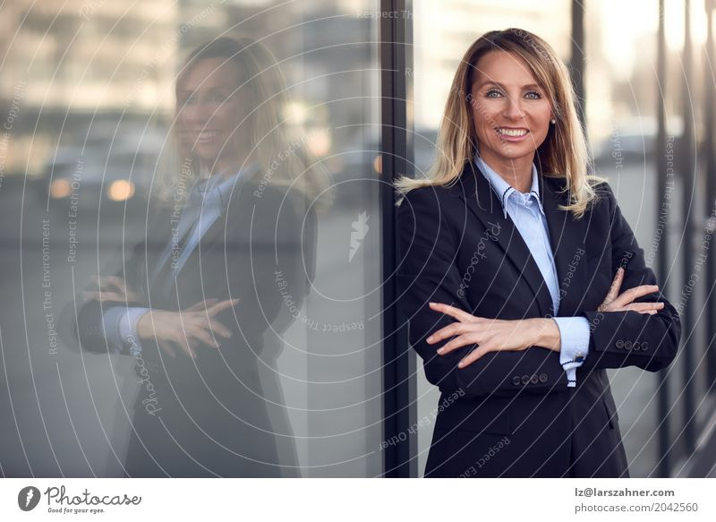Confident female manager leaning on window Human being Woman Blue Adults Happy Business Copy Space Modern Blonde Stand Smiling Suit Self-confident
