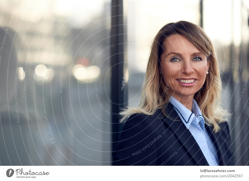 Confident female manager leaning on window Happy Face Business Woman Adults 1 Human being 30 - 45 years Suit Blonde Smiling Stand Modern Blue Self-confident ceo