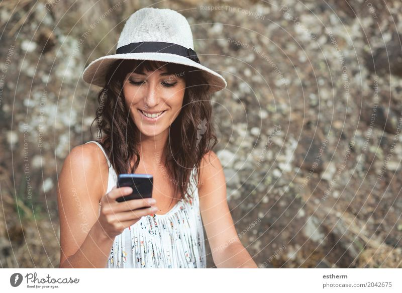 young female using smartphone Human being Woman Youth (Young adults) Young woman Adults Lifestyle Feminine Head Smiling Happiness Telephone Cellphone Hat Long-haired Brunette 30 - 45 years