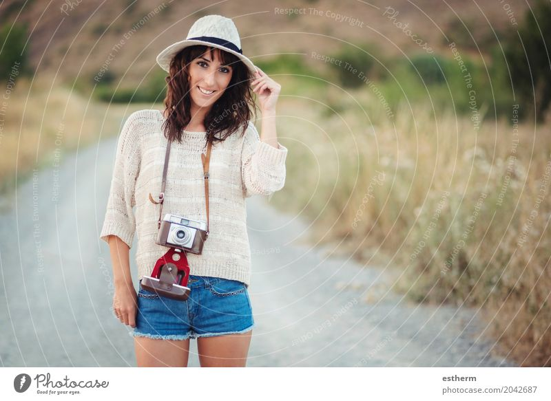 Smiling girl with camera in the field Human being Woman Vacation & Travel Youth (Young adults) Young woman Summer Joy Adults Lifestyle Freedom Tourism Trip Body Happiness Adventure Joie de vivre (Vitality)